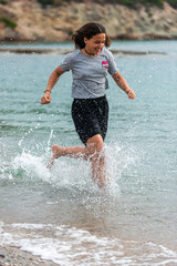 girl running in the surf on the beach
