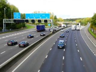 Tilt shift photo of the M25 London Orbital Motorway near Junction 17 in Hertfordshire, UK