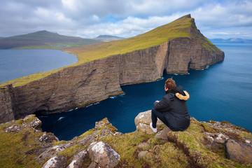 Wall Mural - Hiker looking at the lake Sorvagsvatn on Faroe Islands