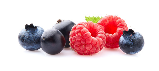 Raspberry, currant and blueberry on white background