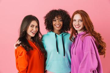 Three cheerful multiethnic girls standing
