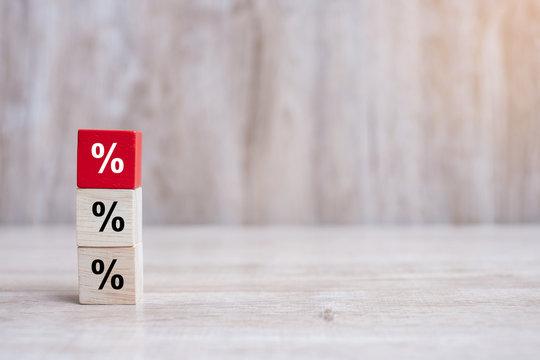 wood cube block with percentage symbol icon. Interest rate,  financial, ranking and mortgage rates concept