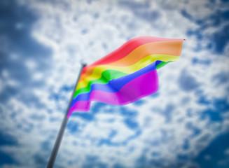 LGBT flag on cloudy sky background