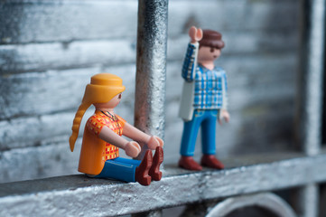 Mulhouse - France - 12 October 2019 - Closeup of PLaymobil characters in outdoor on urban background