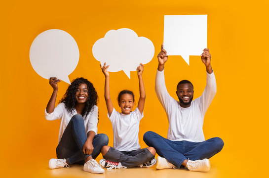 African american family holding empty speech bubbles over heads