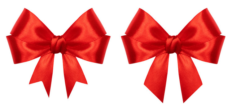 Red gift bow isolated on white background. Ribbon bow of shiny satin closeup. Holiday Christmas decoration as design element
