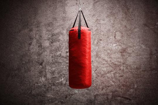 Red boxing bag hanging
