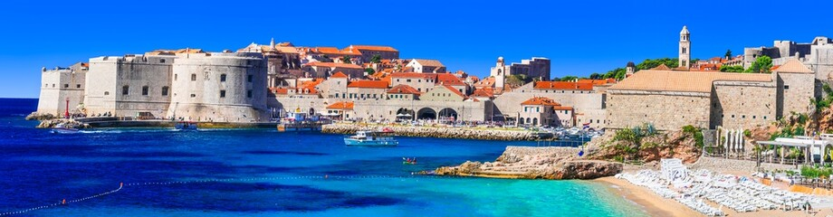Zelfklevend Fotobehang Kust Gorgeous medieval Dubrovnik town - pearl of Adriatic coast in Croatia. Panoramic view with splendid beach