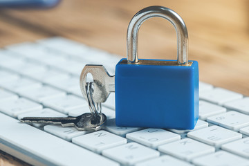 lock and key on keyboard on desk Wall mural