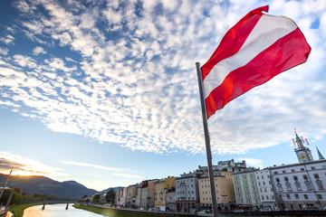 austrian flag over historic salzburg cityscape Fototapete