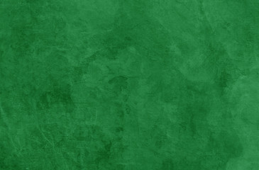 Wall Mural - Green Christmas background texture, old vintage textured holiday paper or wallpaper with painted elegant green colors with marbled stone or rock wall