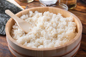 Foto op Aluminium Sushi bar jaoanese sushi rice in wooden bowl with ingredients