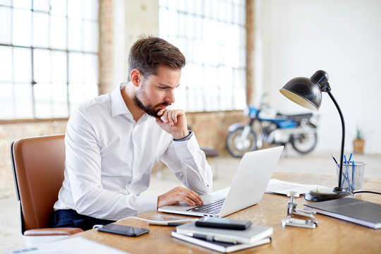 Concentrated businessman with laptop