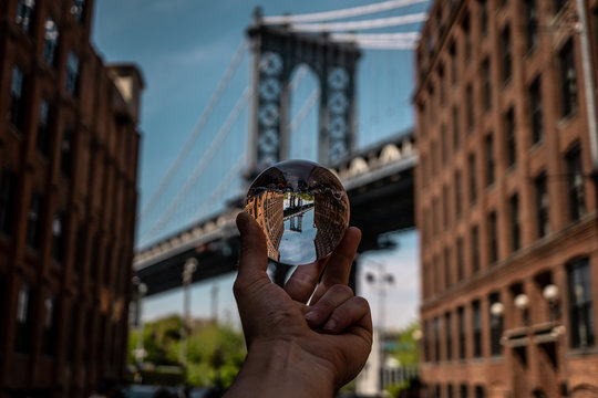 lensball view of one of the towers of the Manhattan Bridge from the streets of the DUMBO district, Brooklyn, NYC, crystal ball image