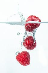 Acrylic Prints In the ice Himbeeren fallen ins Wasser