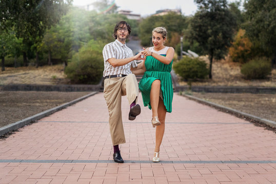 Swing dancers having fun outdoors in the park. Lifestyle concept about people dancing swing music Lindy hop together and having fun!