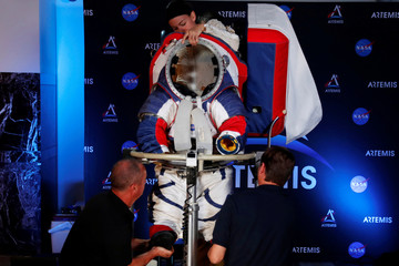 Advanced Space Suit Engineer at NASA Kristine Davis takes off the new xEMU space suit for the next astronaut to the moon by 2024, during its presentation at NASA headquarters in Washington