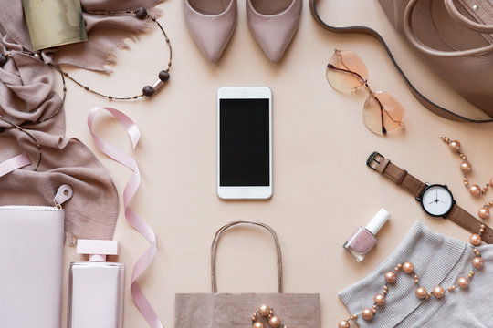 Mock up blank empty smart phone screen on beige fashion women stylish accessories outfit glamour set gifts sale flat lay background, online app shopping mobile ecommerce technology concept, top view
