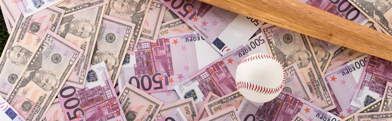 panoramic shot of baseball bat and ball on euro and dollar banknotes, sports betting concept