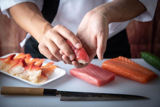 japanese sushi chef making nigiri sushi