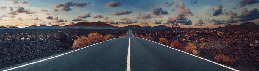 Poster Landscapes Image related to unexplored road journeys and adventures.Road through the scenic landscape to the destination in Lanzarote natural park