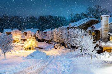 Night snowfall in a New Jersey village with wooden houses.