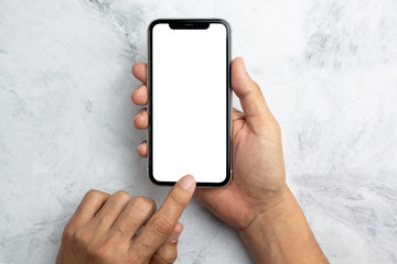 Hand hold a smart phone white screen view from top on marble background
