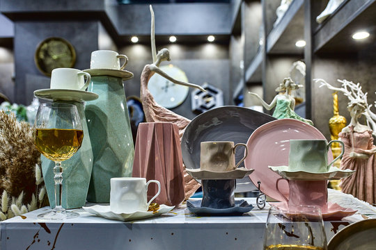a showcase with the laying of porcelain dishes. Beautiful merchandising, dishes for restaurants and hotels