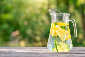 Pitcher of homemade lemonade on wooden table