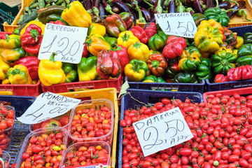 Cherry tomatoes and bell pepper for sale at a market in Naples, Italy