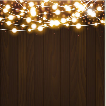 Christmas garlands on wooden background. Xmas lights. Vector