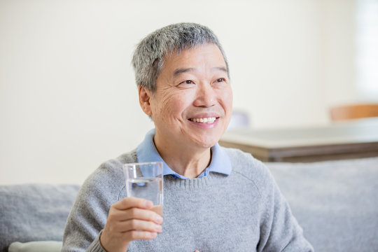 old asian man drink water