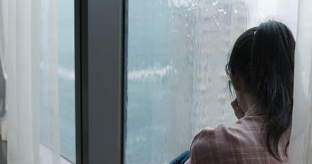 woman cry near by window