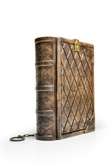 Worn leather book stay up to the table isolated
