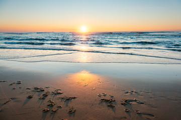 Sunset over the Atlantic Ocean on a sandy beach at Cap Ferret in France. Fototapete