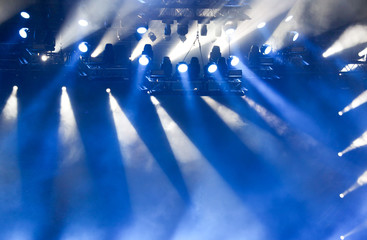 Blue light on a rock concert stage as background