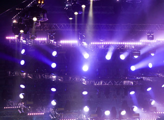 Purple light on a rock concert stage as background