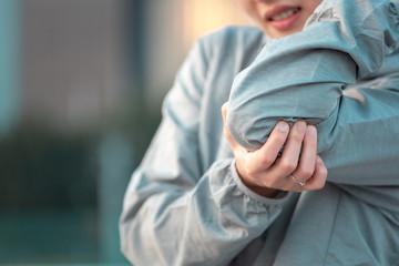 Sporty woman elbow pain
