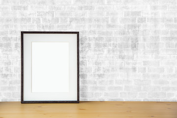 blank picture frame on the white brick wall and the wooden floor, template poster interior photo 3d background