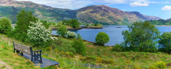 Panoramic image of beautiful Loch Leven viewing Eilean Munde or The burial island in summer , Glencoe , Scotland