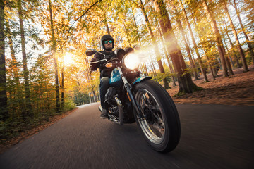 Motorcycle driver riding in foreste landscape