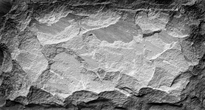 Black and white stone grunge background, rough rock wall texture