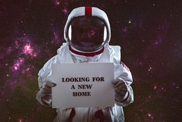 Astronaut leaving earth. Searching for a new home for humanity. Concept about science and nature. showing a message.  Elements provided by NASA