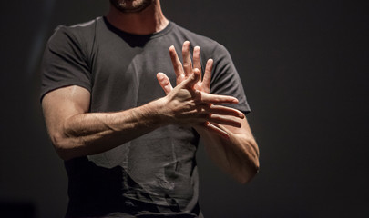 Sign language man interpreter gestures over stage during public event