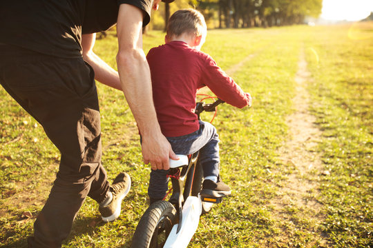 The father teaches son how to cycling