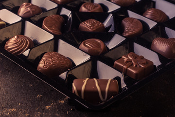 Detail of a box of delicious chocolate bonbons.