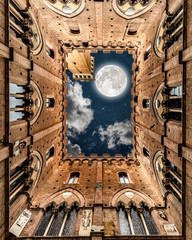 Night Sky With Moon Seen from Inside A Building In Siena Italy