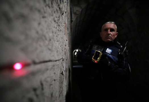A French municipal police officer uses a Taser gun with a laser during an exercise on national security day in Nice