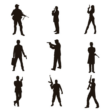 People Holding Firearms Silhouettes