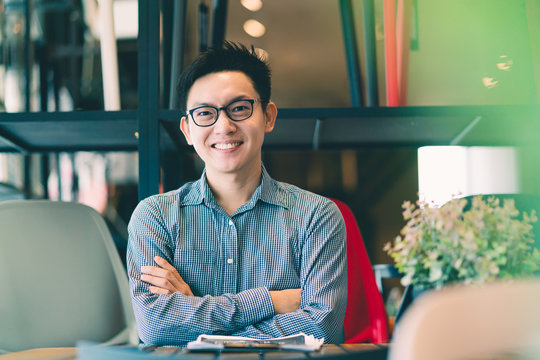 asian businessman startup company   entrepreneur  sit smile with happiness in new shop store office background business ideas concept